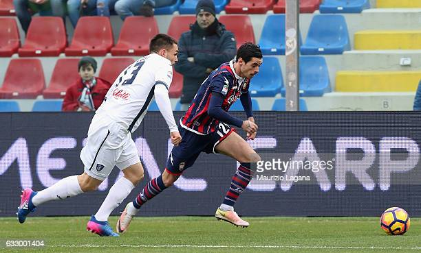 Adrian Stoian of Crotone competes for the ball with Frederic Veseli of Empoli during the Serie A match between FC Crotone and Empoli FC at Stadio...