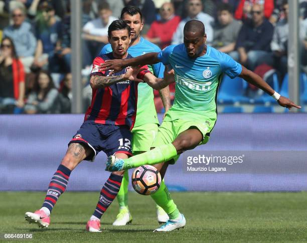 Adrian Stoian of Crotone competes for the ball with Geoffrey Kondogbia of Inter during the Serie A match between FC Crotone and FC Internazionale at...