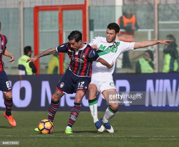 Adrian Stoian of Crotone competes for the ball with Luca Mazzitelli of Sassuolo during the Serie A match between FC Crotone and US Sassuolo at Stadio...
