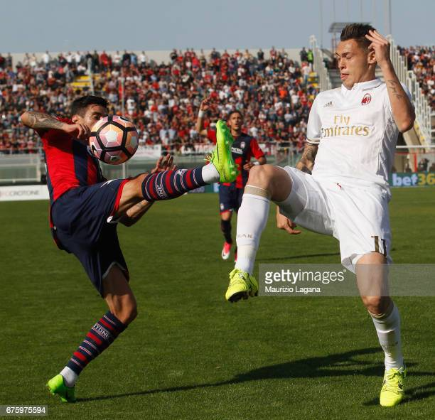 Adrian Stoian of Crotone competes for the ball with Lucas Ocampos of Milan during the Serie A match between FC Crotone and AC Milan at Stadio...