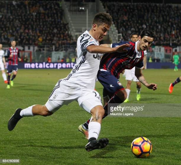 Adrian Stoian of Crotone competes for the ball with Paulo Dybala of Juventus during the Serie A match between FC Crotone and Juventus FC at Stadio...
