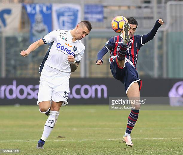 Adrian Stoian of Crotone competes for the ball with Rade Krunic of Empoli during the Serie A match between FC Crotone and Empoli FC at Stadio...