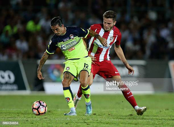 Adrian Stoian of Crotone competes for the ball with Saul Niguez of Atletico de Madrid during presseason friendly match between FC Crotone and Club...