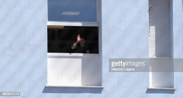 Adrian Stoian of Crotone watches the match from hospital window near the stadium during the Serie A match between FC Crotone and Udinese Calcio at...