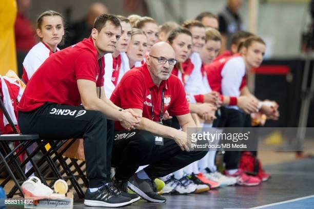 Adrian Struzik and Leszek Krowicki head coach of Poland during IHF Women's Handball World Championship group B match between Argentina and Poland on...