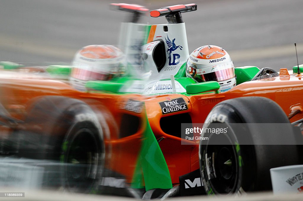 <a gi-track='captionPersonalityLinkClicked' href=/galleries/search?phrase=Adrian+Sutil&family=editorial&specificpeople=750787 ng-click='$event.stopPropagation()'>Adrian Sutil</a> of Germany and Force India drives during the final practice session prior to qualifying for the British Formula One Grand Prix at the Silverstone Circuit on July 9, 2011 in Northampton, England.