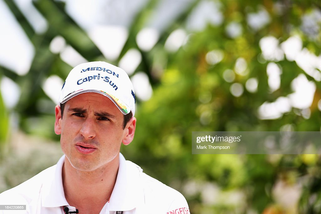 Adrian Sutil of Germany and Force India is interviewed in the paddock during previews to the Malaysian Formula One Grand Prix at the Sepang Circuit on March 21, 2013 in Kuala Lumpur, Malaysia.