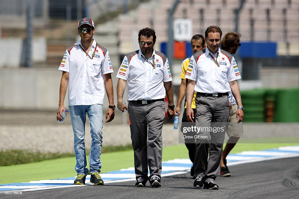 Adrian Sutil of Germany and Sauber F1 walks along the track with members of his team during previews ahead of the German Grand Prix at Hockenheimring on July 17, 2014 in Hockenheim, Germany.