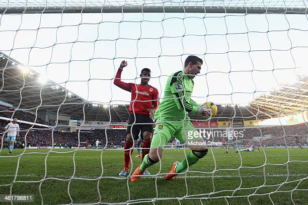 Adrian the goalkeeper of West Ham United clutches the ball on the line as Fraizer Campbell of Cardiff City claims a goal during the Barclays Premier...
