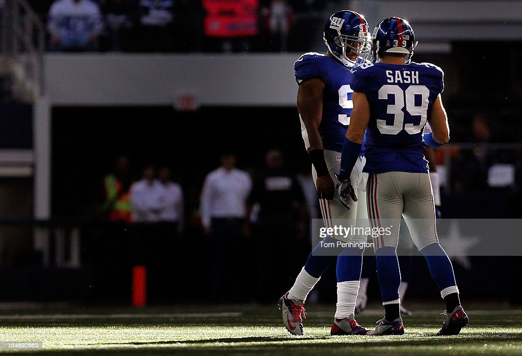 Adrian Tracy #98 of the New York Giants and <a gi-track='captionPersonalityLinkClicked' href=/galleries/search?phrase=Tyler+Sash&family=editorial&specificpeople=5544685 ng-click='$event.stopPropagation()'>Tyler Sash</a> #39 of the New York Giants prepare for a play against the Dallas Cowboys at Cowboys Stadium on October 28, 2012 in Arlington, Texas. The New York Giants beat the Dallas Cowboys 29-26.