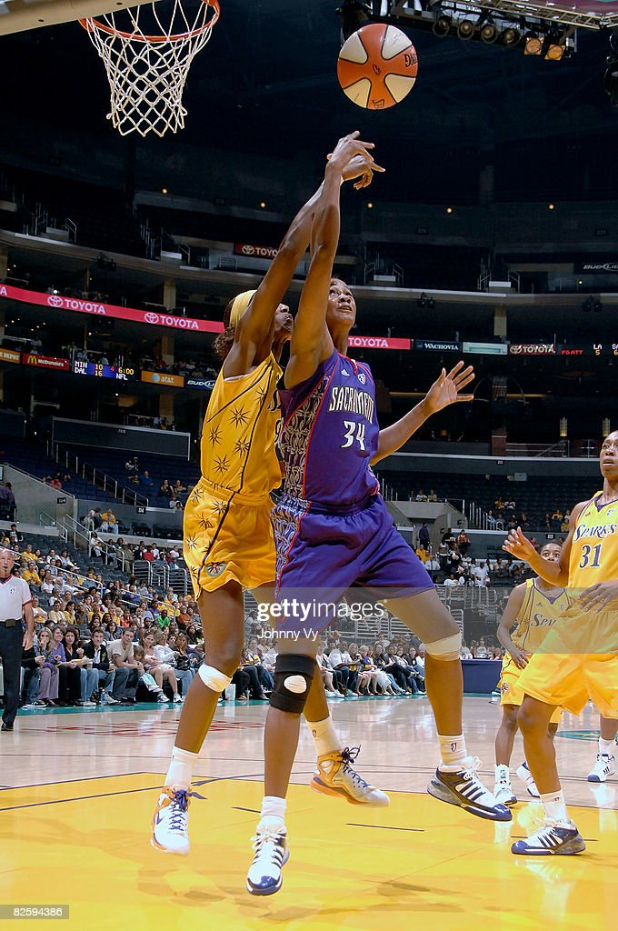 Adrian WilliamsStrong of the Sacramento Monarchs goes up for a shot against Lisa Leslie of the Los Angeles Sparks during their game on August 28 2008...