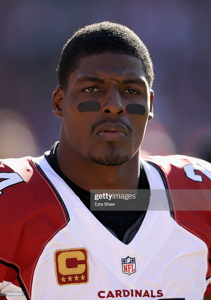 <a gi-track='captionPersonalityLinkClicked' href=/galleries/search?phrase=Adrian+Wilson+-+American+Football+Player&family=editorial&specificpeople=773272 ng-click='$event.stopPropagation()'>Adrian Wilson</a> #24 of the Arizona Cardinals stands on the sidelines before their game against the San Francisco 49ers at Candlestick Park on December 30, 2012 in San Francisco, California.