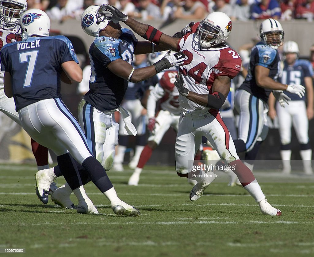 <a gi-track='captionPersonalityLinkClicked' href=/galleries/search?phrase=Adrian+Wilson+-+American+Football+Player&family=editorial&specificpeople=773272 ng-click='$event.stopPropagation()'>Adrian Wilson</a> strong safety for the Arizona Cardinals rips the helmet off #33 Jarrett Payton while pass rushing in a game against the Tennessee Titans at Sun Devil Stadium in Tempe, Arizona on October 23, 2005.