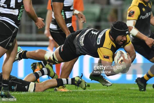 Adrian Wyrill of Taranaki dives to score a try during the round six Mitre 10 Cup match between Hawke's Bay and Taranaki at McLean Park on September...