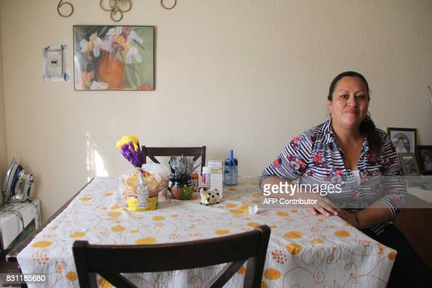 Adriana Aguero an operator in an industrial park poses for a picture at home in Ciudad Juarez Chihuahua state Mexico on August 10 2017 Many workers...