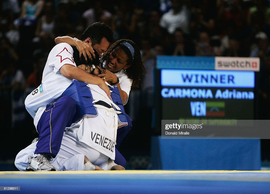 Adriana Carmona of Venezuala celebrates defeating Natalie Silva of Brazil in the women's over 67 kg Taekwondo bronze medal match on August 29, 2004 during the Athens 2004 Summer Olympic Games at the Sports Pavilion part of the Faliro Coastal Zone Olympic Complex.