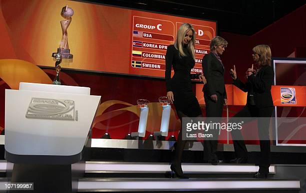 Adriana Karambeu is seen next to head coach Silvia Neid of Germany and headcoach Carolina Morace of Canada during the offical FIFA 2011 Women's World...
