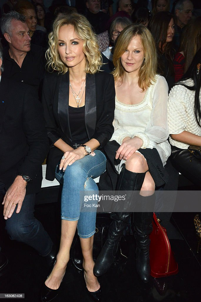 Adriana Karembeu (L) and a guest attend the John Galliano - Front Row - PFW F/W 2013 at Le Centorial on March 3, 2013 in Paris, France.