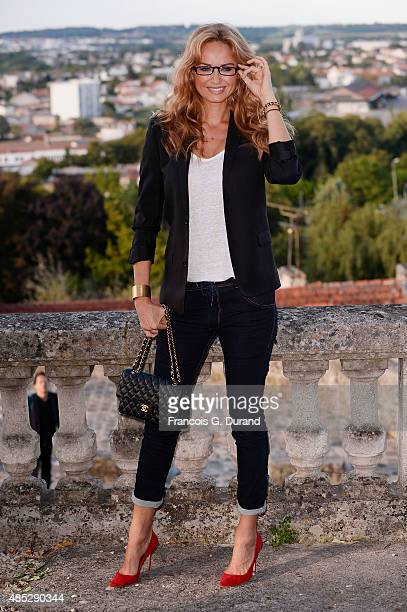 Adriana Karembeu poses at a photocall during the 8th Angouleme FrenchSpeaking Film Festival on August 26 2015 in Angouleme France