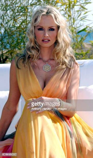 Adriana Karembeu poses for photographers during a photocall at the Martinez Hotel to promote the Liban tourist board during the 56th Cannes Film...