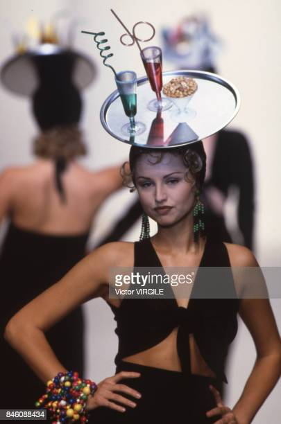 Adriana Karembeu walks the runway at the Tarlazzi Ready to Wear Spring/Summer 1993 fashion show during the Paris Fashion Week in October 1992 in...