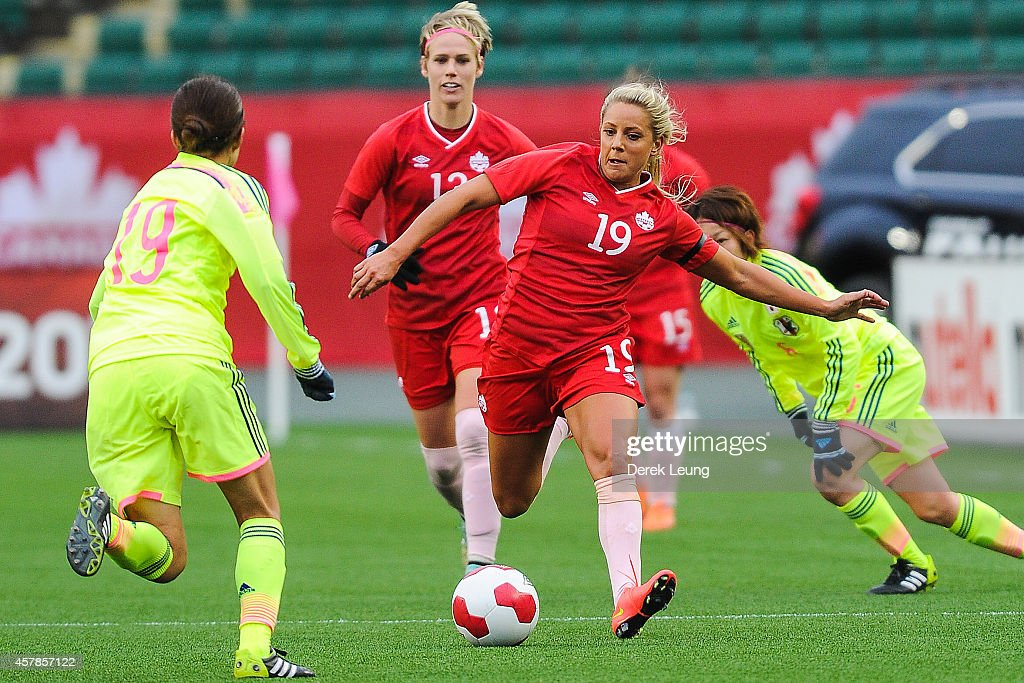 Adriana Leon #19 of Canada runs with the ball against Japan during a match at Commonwealth Stadium on October 25, 2014 in Edmonton, Alberta, Canada.