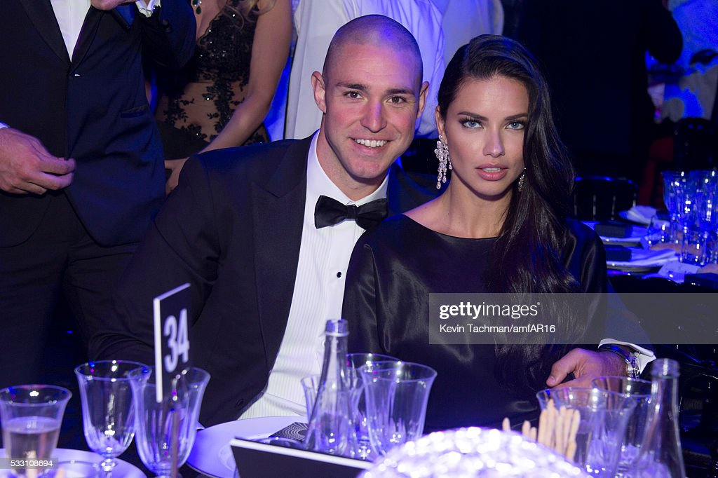 Adriana Lima amd Joe Thomas attend the amfAR's 23rd Cinema Against AIDS Gala at Hotel du CapEdenRoc on May 19 2016 in Cap d'Antibes France