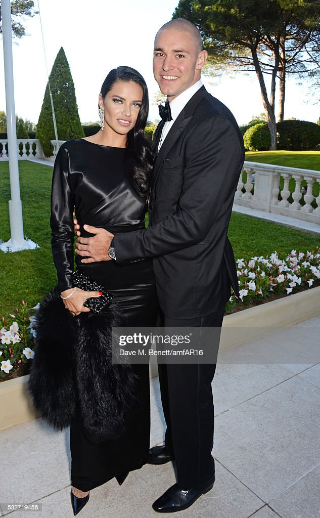 Adriana Lima and Joe Thomas attend amfAR's 23rd Cinema Against AIDS Gala at Hotel du CapEdenRoc on May 19 2016 in Cap d'Antibes France