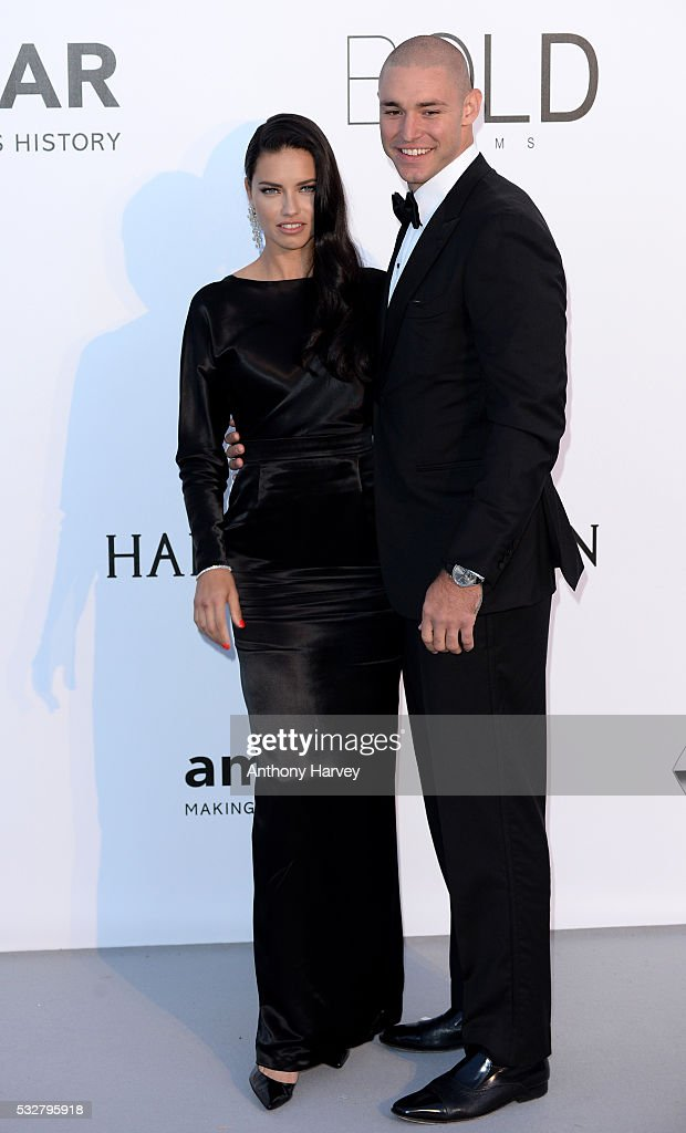 Adriana Lima and Joe Thomas attend the amfAR's 23rd Cinema Against AIDS Gala at Hotel du CapEdenRoc on May 19 2016 in Cap d'Antibes France