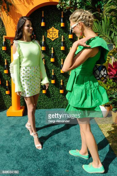 Adriana Lima and Karolina Kurkova attend Veuve Clicquot hosts Third Annual Clicquot Carnaval supporting the Perez Art Museum Miami in Museum Park on...