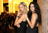 Adriana Lima and Karolina Kurkova visit the IWC booth during the Salon International de la Haute Horlogerie 2015 at the Palexpo on January 20 2015 in...