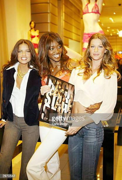 Adriana Lima Oluchi Onweagba and Gisele Bundchen pose for a photo during the in store book launch for the new Victoria's Secret photo book 'Backstage...