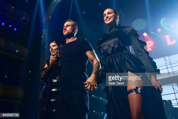 Adriana Lima Philipp Plein and Irina Shayk walk the runway for the finale at the Philipp Plein fashion show during New York fashion week at...