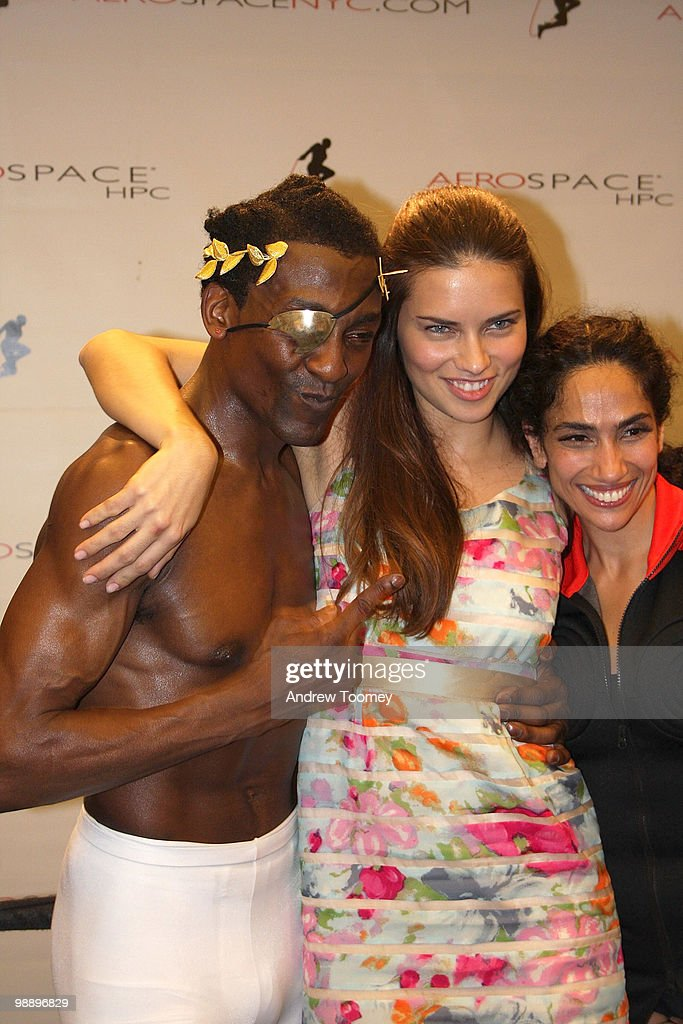 Adriana Lima (C) poses with Owner Michael Olajide (L) and Leila Fazel (R) at the 3rd Annual Aerospace Fight for Fitness Competition at the Aerospace High Performance Center on May 6, 2010 in New York City.