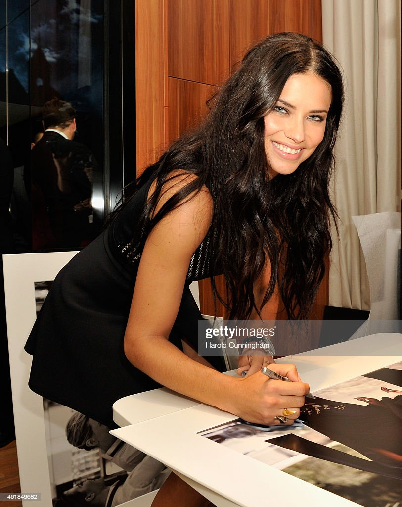 Adriana Lima visits the IWC booth during the Salon International de la Haute Horlogerie (SIHH) 2015 at the Palexpo on January 20, 2015 in Geneva, Switzerland.