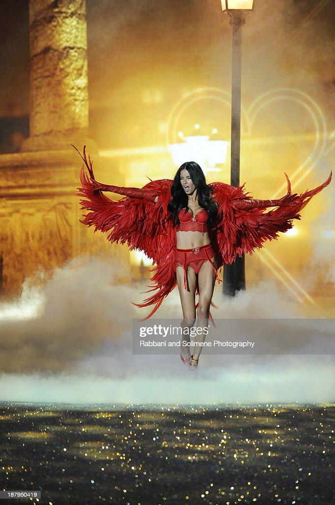 Adriana Lima walks in the 2013 Victoria's Secret Fashion Show at Lexington Avenue Armory on November 13, 2013 in New York City.