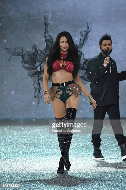 Adriana Lima walks the runway as The Weeknd performs at the Victoria's Secret Fashion Show on November 30 2016 in Paris France