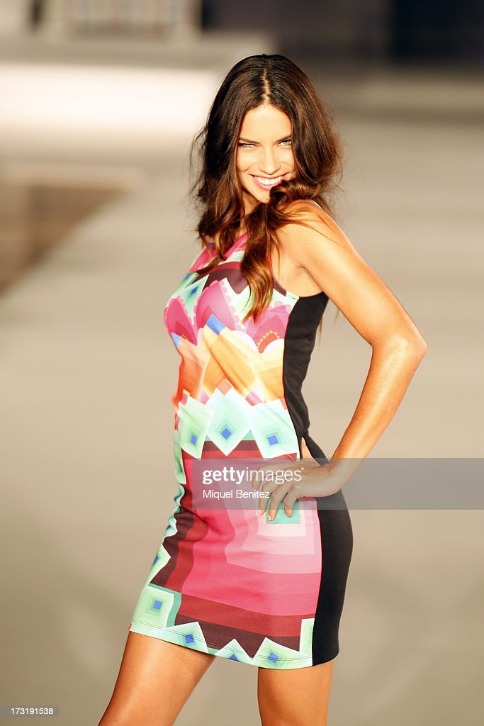 <a gi-track='captionPersonalityLinkClicked' href=/galleries/search?phrase=Adriana+Lima&family=editorial&specificpeople=182444 ng-click='$event.stopPropagation()'>Adriana Lima</a> walks the runway of 'For Everyboby Sex Fun and Love by Desigual's' new collection during the 080 Barcelona Fashion Spring Summer 2014 on July 9, 2013 in Barcelona, Spain.