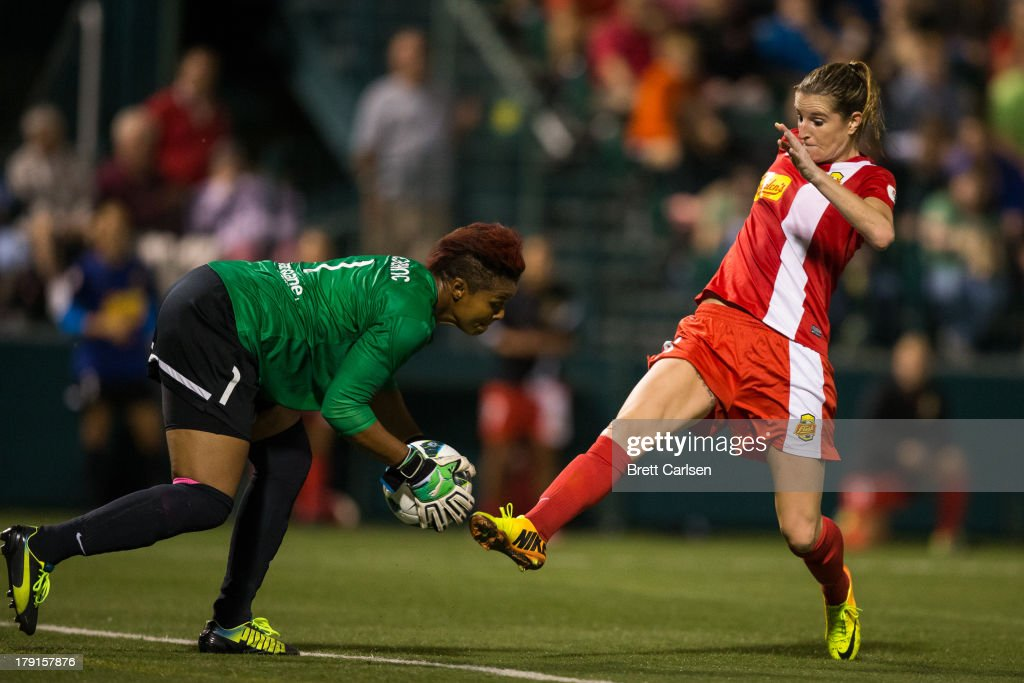 Adriana Martin #8 of Western New York Flash attempts to kick the ball out of the hands of Portland Thorns FC's Karina LeBlanc #1 which resulted in a yellow card for Martin in the National Women's Soccer League Championship at Sahlen's Stadium August 31, 2013 in Rochester, New York.