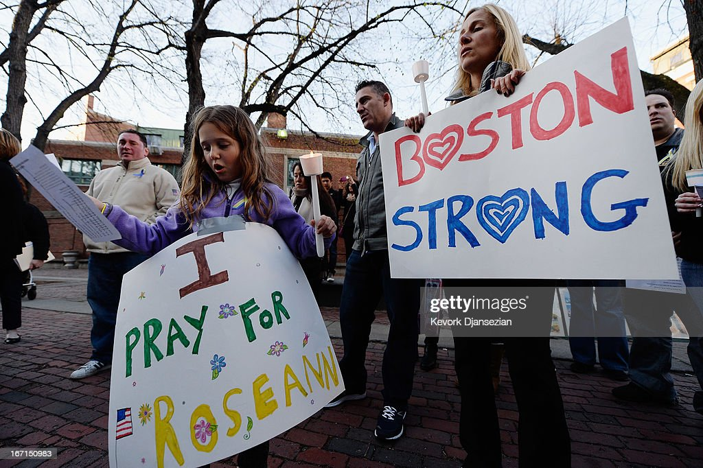 Adriana Passacantilli, 7, and her mother Sue participate in a candelight vigil for Roseann Sdoia who was seriously injured during the Boston Marathon bombings on April 21, 2013 in Boston, Massachusetts. A manhunt for Dzhokhar A. Tsarnaev, 19, a suspect in the Boston Marathon bombing ended after he was apprehended on a boat parked on a residential property in Watertown, Massachusetts. His brother Tamerlan Tsarnaev, 26, the other suspect, was shot and killed after a car chase and shootout with police. The bombing, on April 15 at the finish line of the marathon, killed three people and wounded at least 170.