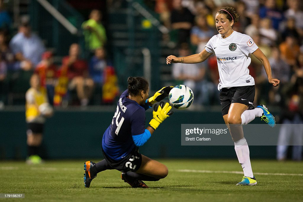 Adrianna Franch #24 of Western New York Flash grabs a ball to stop stock an attack by Danielle Foxhoven #9 of Portland Thorns FC in the National Women's Soccer League Championship at Sahlen's Stadium August 31, 2013 in Rochester, New York.