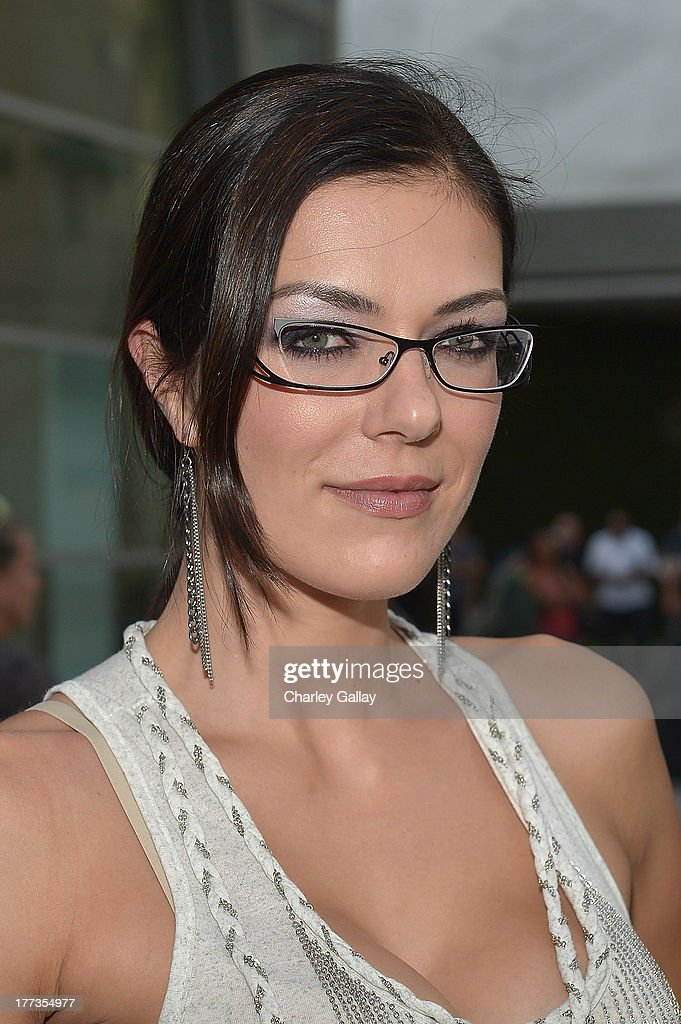 <a gi-track='captionPersonalityLinkClicked' href=/galleries/search?phrase=Adrianne+Curry&family=editorial&specificpeople=715970 ng-click='$event.stopPropagation()'>Adrianne Curry</a> arrives at a screening of The Weinstein Company And Annapurna Pictures' 'The Grandmaster' at the Arclight Theatre on August 22, 2013 in Los Angeles, California.