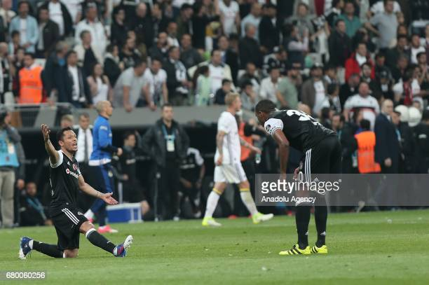 Adriano and Marcelo of Besiktas react after the Turkish Spor Toto Super Lig soccer match between Besiktas and Fenerbahce at Vodafone Arena in...