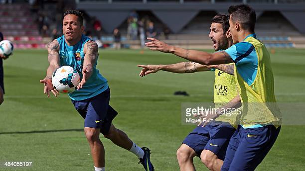 Adriano Cesc Fabregas and Cristian Tello of FC Barcelona play with the ball during the training session at Ciutat Esportiva on April 11 2014 in...