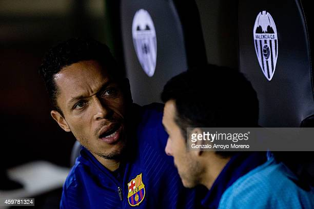Adriano Correia Claro of FC Barcelona gestures close to his teammate Pedro Rodriguez Ledesma sitted on the bench prior to start the La Liga match...