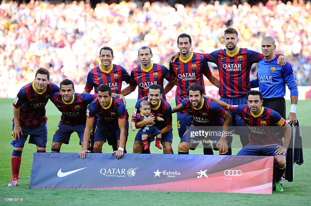Adriano Correia, Javier Mascherano, Sergio Busquets, Gerard Pique, Victor Valdes (Front row L-R) Lionel Messi, Dani Alves, Alexis Sanchez, Pedro Rodriguez with his son, Cesc Fabregas and Xavi Hernandez prior to the La Liga match between FC Barcelona and Levante UD on August 18, 2013 in Barcelona, Spain.