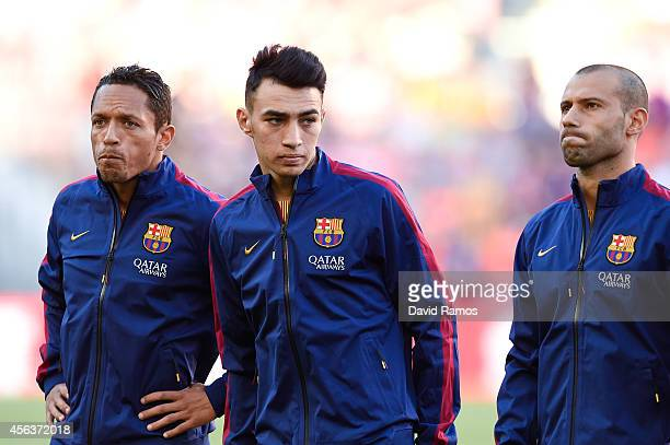 Adriano Correia Munir El Haddadi and Javier Mascherano of FC Barcelona look on during the La Liga match between FC Barcelona and Granada CF at Camp...