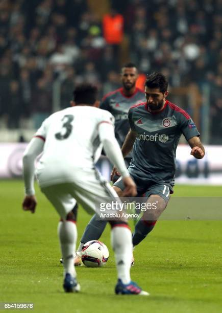 Adriano Correia of Besiktas in action against Karim Ansarifard of Olympiacos during the UEFA Europa League Round 16 secondleg match between Besiktas...