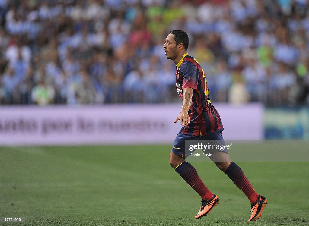 Adriano Correia of FC Barcelona celebrates after scoring his team's opening goal during the La Liga match between Malaga CF and FC Barcelona at La Rosaleda Stadium on August 25, 2013 in Malaga, Spain.