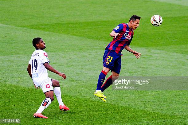 Adriano Correia of FC Barcelona clears the ball under pressure from Ivan Cavaleiro of RC Deportivo La Coruna during the La Liga match between FC...